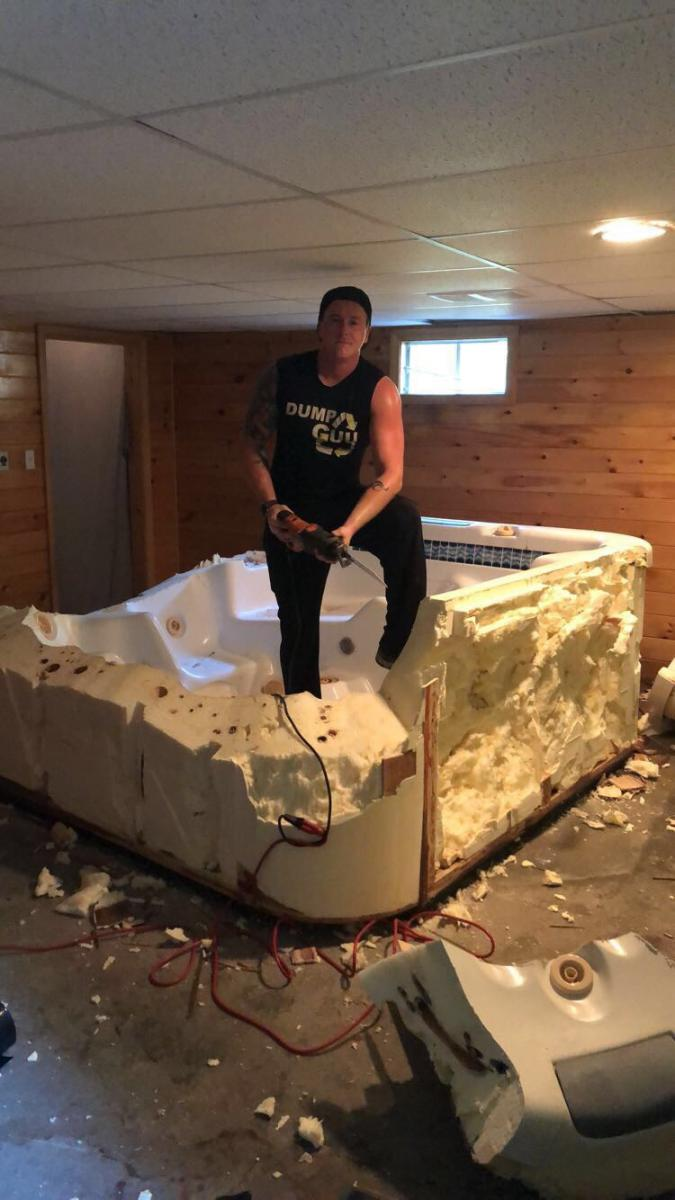Man destroying a hot tub